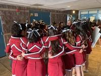 Team circle of motivation before hitting the mats.